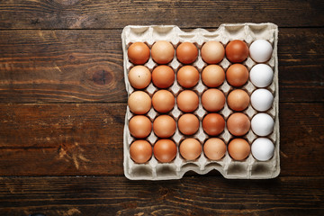 chicken eggs on a wooden background