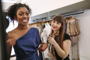 Fashion designer designing clothes in her fashion design studio