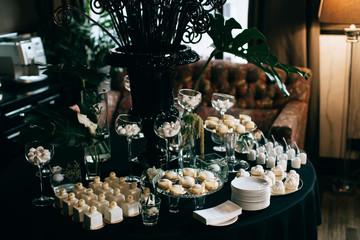 elegant dessert table at the wedding. black decoration