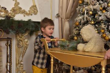 boy in checkered shirt at christmas