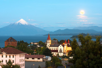 Moon rising on Puerto Varas at the shores of Lake Llanquihue with Osorno Volcano in the back, X Region de Los Lagos, Chile