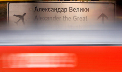 A bus passes a sign for Alexander the Great Airport which was removed due to road construction in Skopje