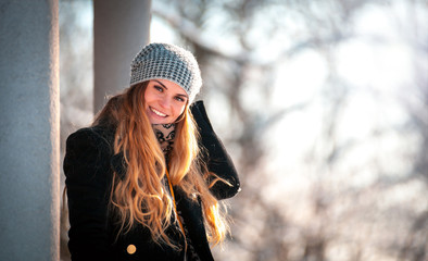 Happy winter time, smiling young woman in the park