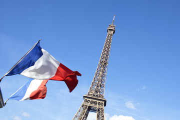 Eiffel Tower of Paris with flags of France