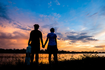 Sweet man and woman on sunset background