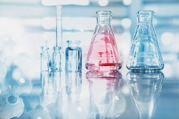 blue red glass flask vial and chemical structure in research medical science technology background