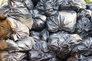 Many pile garbage black bag plastic