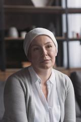 portrait of sick mature woman in kerchief, cancer concept