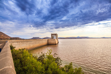 Foto op Plexiglas Afrika The dam wall at the Gariep dam in South Africa. This is a very large dam which holds a vast amount of water.