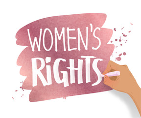 Female hand writing Women Rights