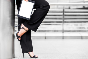 business woman wear high heel and hold tablet