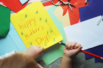 Happy Mothers day.The child draws a greeting card. children's postcard