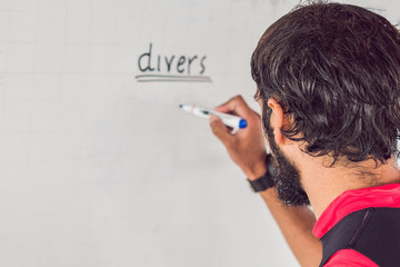 diver writes a marker on the board