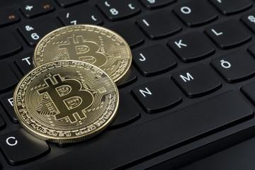 Bitcoins on computer keyboard