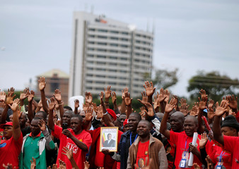 Mourners react at the funeral parade held for the late MDC leader Morgan Tsvangirai in Harare