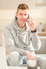 Portrait of smiling man speaking on mobile phone