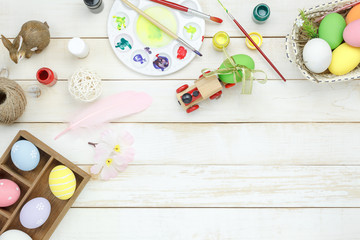 Table top view shot of decoration Happy Easter holiday background concept.Arrangement item to paint activity on the modern rustic white wooden table at home office desk.Negative space for creative.