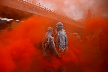 """Revellers celebrate """"Ash Monday"""" by participating in a colourful """"flour war"""", a traditional festivity marking the end of the carnival season and the start of the 40-day Lent period until the Orthodox Easter, in Galaxidi"""