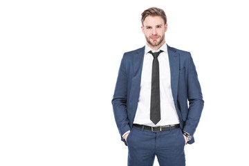 portrait of caucasian businessman in suit with hands in pockets isolated on white Fotobehang