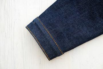 denim jeans on wooden