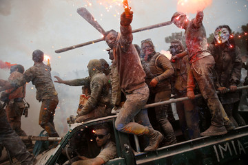 "Revellers celebrate ""Ash Monday"" by participating in a colourful ""flour war"", a traditional festivity marking the end of the carnival season and the start of the 40-day Lent period until the Orthodox Easter, in Galaxidi"