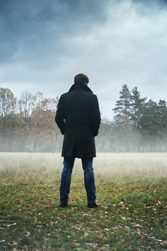 the man is standing in the field