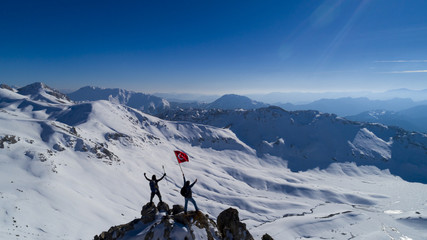 turkish flag waving in the summit mountains
