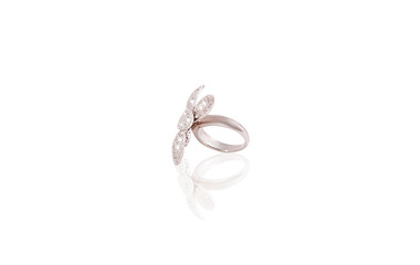 Platinum precious  ring flower female with diamonds on white isolated background.