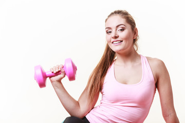 Sporty girl lifting weights.