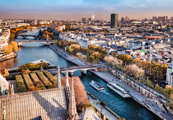 High resolution aerial panorama of Paris, France. The river Seine and autumn colors with blue sky.