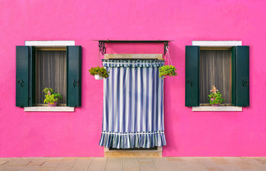 BURANO, ITALY - 2 Septenber,  2016. Pink color of walls in Burano island near Venice, Italy.