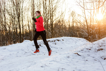 Photo of happy sportswoman on morning run in winter