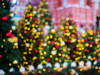 Christmas blurred image of decorated spruce in street