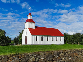 Modruvalla church with red roof on a sunny day