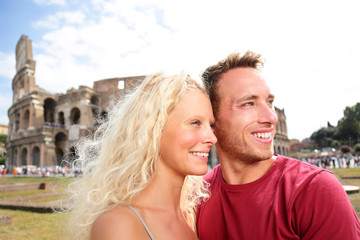 Wall Mural - Europe summer travel tourists people happy smiling healthy lifestyle. Young couple in love by Colosseum, Rome, Italy. Traveling tourist man and blonde woman on holidays vacation.