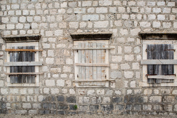 boarded-up Windows in an old stone building