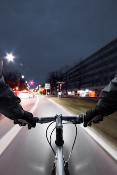 Cyclist drives on the bike path past the traffic jam. - First-person view of cyclist