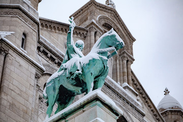 Snow covered statue in Paris
