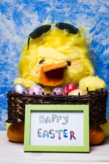 Happy Easter card with toy chicken and painted eggs