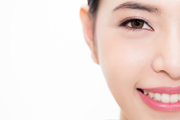 Close-up of Young beauty Asian face focused on eyes, beautiful woman isolated over white background. Healthcare and Eye care concept.