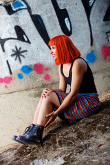 Attractive girl with red hair in the street
