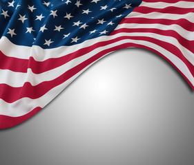 USA flag on grey. Copy space