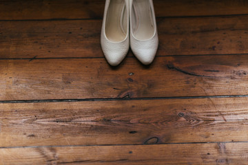 white shoes on a brown background