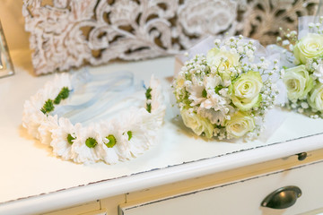 Bridal wreath with flowers and wedding bouquets