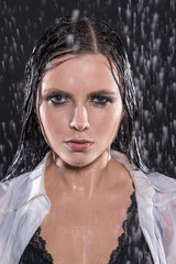 Wet young sexy woman in aqua studio under the water drops.