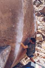 Young Man Bouldering the Atari Wall in Bishop