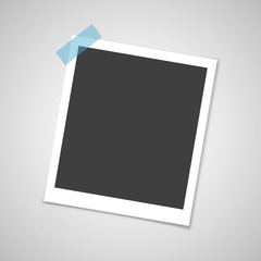 Retro photo frame with shadow on sticky tape pin on a grey background