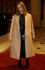 Fashion designer McCartney poses for a photograph as she arrives at the Commonwealth Fashion Exchange Reception at Buckingham Palace in London