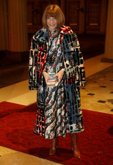 Wintour of American Vogue magazine poses for a photograph as she arrives at the Commonwealth Fashion Exchange Reception at Buckingham Palace in London