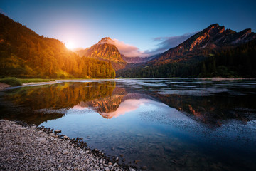 Wall Mural - Great view of the azure pond Obersee glowing by sunlight. Location Nafels, Swiss alps, Europe.